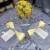YELLOW AND SILVER OVERSTUFFED CENTERPIECE TABLE