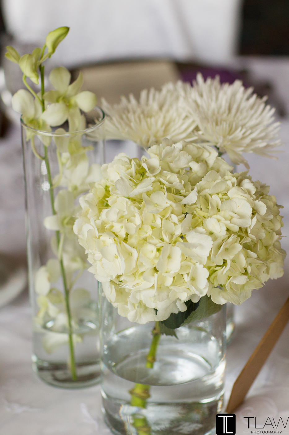 Simple Centerpiece of Hydrangea, Dendrobium Orchids and Spider Mums.