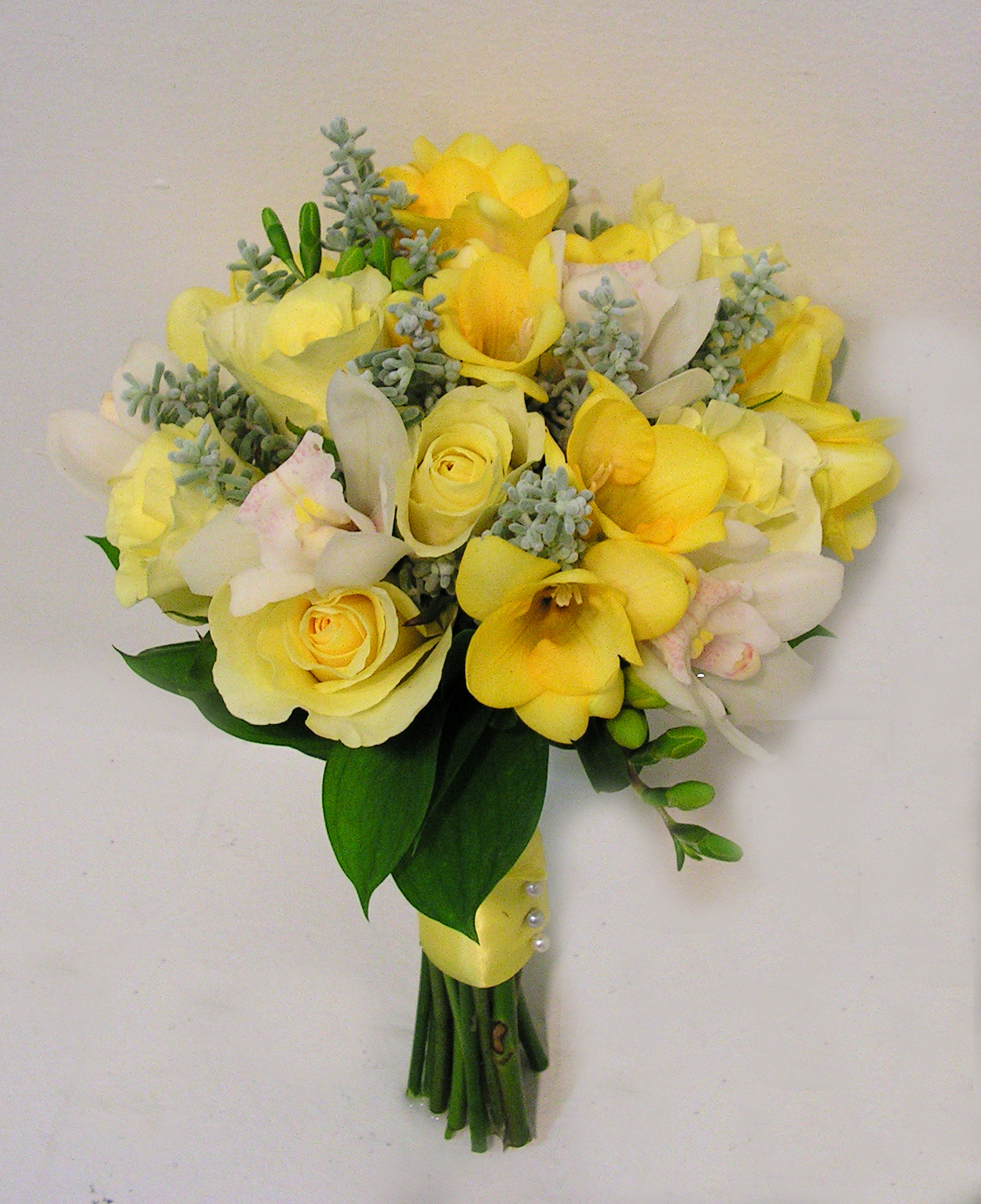yellow freesia with roses and silver foliage bouquet