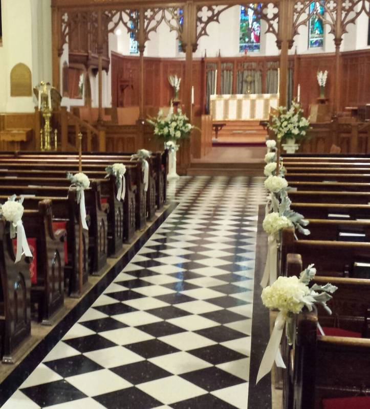 Wedding Altar Setup: Church Pew Ends And Altar Flowers