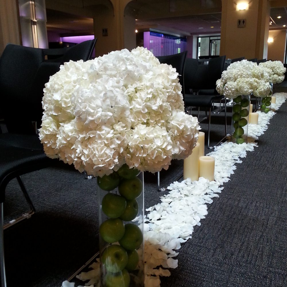 aisle-epcor-center-lobby-ceremony-pieces-ivory-hydrangea-on-apple-filled-vases